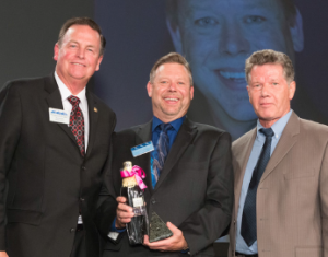 Distinguished Community Leader given to Kevin Moore (middle).